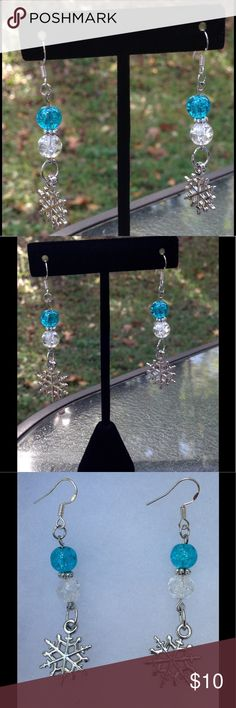 Blue and White Snowflake Earrings These lovely earrings are made with sparkling blue and white glass beads. The snowflake charms are silvertone, and the hooks are sterling silver.   All PeaceFrog jewelry items are handmade by me! Take a look through my boutique for coordinating jewelry and more unique creations. PeaceFrog Jewelry Earrings