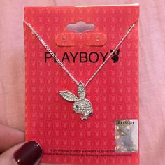 Playboy Bunny Necklace Never worn Playboy necklace. Super cute! The bunny is covered in silver rhinestones with one blue rhinestone for the eye. Playboy Jewelry Necklaces