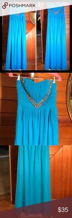 """Turquoise Blue Floor Length Prom Dress Turquoise blue floor length dress by Jane Norman London. Pleated and it has a heart shaped sequence on chest. Flowy chiffon with satin fabric lining. 100%polyester. Lining: 94%polyester, 6%elastane. Bought in Dubai, used only once in Nov.2017 as bridesmaid to my bff wedding in San Diego. But this also perfect for prom events. It has silicone edges for better grip. Size 12. Approx 52"""" long (from chest   To hem. Comes with 1 thin strap for style option…"""