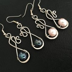 Hand made silver wire pearl earrings. by BLLstudio