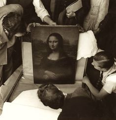 Mona Lisa during WWII  She was packed up and moved out of the Louvre before the Germans arrived.  She was moved 5 times to avoid being looted.
