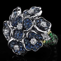 Blue and Yellow Sapphire, Diamond, and Tsavorite ring set in 18k white gold by Robert Procop