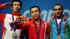 Wu Jingbiao reacts in Weightlifting competition