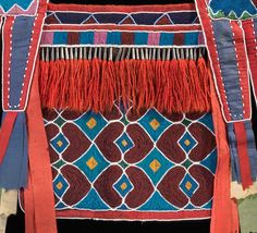 Fringe (detail), Bandolier Bag, Lenape (Delaware tribe, based in Oklahoma), c. 1850 C.E., hide, cotton cloth, silk ribbon, glass beads, wool yarn, metal cones, 68 x 47 cm (National Museum of the American Indian, New York)