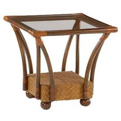 """Hand-rubbed wood and cane end table with leather-wrapped corners.     Product: End table   Construction Material: Wood, glass and leather  Color: Honey glaze  Features:     Beautifully woven base  Bun feet  Leather wrapped corners     Dimensions: 23.37"""" H x 23.37"""" W x 23.37"""" D"""