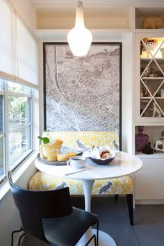 Making room for a banquette -- Don't give up when space is tight. A small pedestal table can tuck in almost anywhere, and a tight two-person banquette cozies it up.