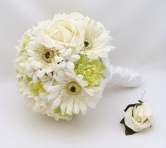 something like this but when the yellowish flowers are, think bling!  Then the stems wrapped with bling too??  I think it would be gorgeous!  A white gerbera daisy for Scott's bouttonierre