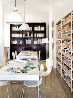 Storage/ work tables/ sisal rugs.  Suzanne Kasler's office from Atlanta Homes & Lifestyles