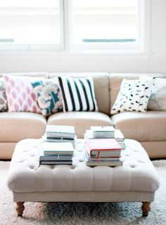 Oh I love all of this! The pillows, the couch, the coffee table, the books ...