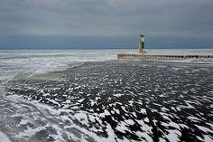 """Winter wind""  St. Joseph Northpier Lighthouse,St. Joseph, Michigan"