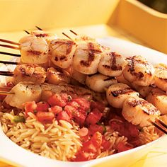 26 Delicious Scallop Recipes | Grilled Scallops with Tomato-Mint Sauce ...