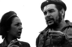 Celia Sánchez (1920 – 1980) smokes with Che Guevara. Sánchez as a notable participant of the Cuban Revolution. She joined the struggle against the Fulgencio Batista dictatorship following the coup of March 10, 1952, and was credited as the founder of the 26th of July Movement in Manzanillo. Among the many other pivotal roles she played, she was one of the first women to assemble a combat squad during the revolution, and even made the arrangements for the Granma landing