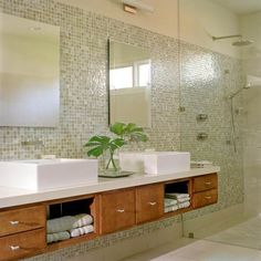 Weeks 6: Faucets/Fixtures: i love the oversized look and feel of the vanity, sinks and even the stand up shower,it really offers a space that feels very large and open. the faucet fixtures are simple they almost blend in the with wall.  Source:  http://www.bhg.com/bathroom/vanities/open-vanity-bath-storage/#page=21