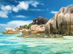 """Though you may be tempted to try and visit all 116 plus of the islands of the Seychelles, even the most intrepid travelers will find it difficult to island-hop without a yacht at hand. This grouping of islands is revered for its untouched beaches (some have never been visited) and uninhabited island preserves home to giant tortoises and a type of coconut with such a sensuous shape it's been nicknamed the """"love nut."""""""
