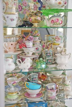 Tea cabinet - If I were to collect tea cups, this is what I'd want it to look like. Vintage Dishes, Vintage China, Vintage Tea, Tea For One, My Cup Of Tea, Tea Cup Set, Tea Sets, Tea Cup Display, Tea Party Decorations