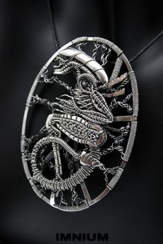 Hey, I found this really awesome Etsy listing at https://www.etsy.com/listing/177826947/alien-pendant-black-diamond-sterling-and
