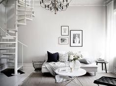 This home with white floors and walls has a very soft but at the same time graphic look. The bedroom is painted in a warm grey, which is visible from the living room through these beautiful wing doors. My Living Room, Living Spaces, Gravity Home, Have A Lovely Weekend, Interior Decorating, Interior Design, Scandinavian Home, Living Room Inspiration, Elle Decor