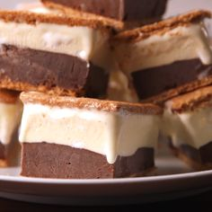 If you like s'mores, you'll LOVE frozen s'mores. Get the recipe at Delish.com. #delish #easy #recipe #frozen #smores #icecream #summerdessert #frozendessert #icecreamdessert #icecreamsandwich