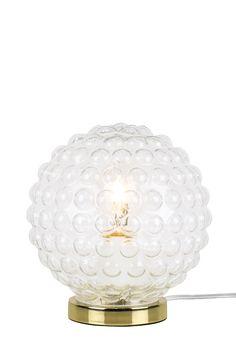 Bordlampe Spring er laget i klart boblete 20-talls glass som gir en spennende lysspredning. Fot i metall og transparent ledning med bryter. Høyde 20 cm. Diameter 17 cm. Pæreholder E27. Maks 40w. Pære inngår ikke.