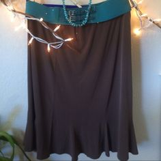 Susan Graver Skirt size XL Chocolate brown skirt with flare at the bottom. Elastic waistband. Comfortable enough to wear on a plane or pair with some flats to run errands! Susan Graver Skirts A-Line or Full