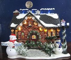 Dept 56 Snow Village ~ The Snowman House.  I have this one in my collection