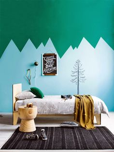 Love the use of blue and green on the walls in this childrens bedroom
