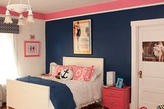 Coral and Navy Bedroom. Love these colors but that poster above the bed really throws it off...