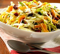 Coleslaw with Cranberries and Apricots Serve this tangy fruit-flecked coleslaw at a fall feast.