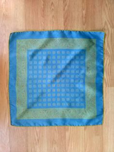Nice, muted colors  Blue, green, orange  Paisley  Squares  Silky acetate  Rolled edge    Pocket scarves... SO sophisticated.    Stamp/label: none