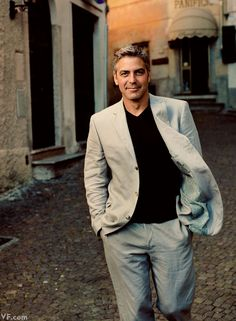 "George Clooney, who owns one of the Lake Como's prized Italian villas, takes a stroll through Argegno. Photographed by Annie Leibovitz for Vanity Fair's article, ""Crazy for Como,"" September 2007 issue (photo originally published October Famous Photos, Famous Faces, Vanity Fair, Fashion Mode, Mens Fashion, Fashion Trends, Gorgeous Men, Beautiful People, Celebridades Fashion"