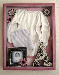 the clothes that baby came home in...cute! Much better than a box in the attic! Cute idea!