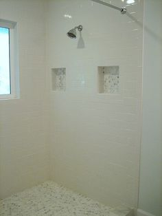 Shower tile idea - mix ceramic subway tile with marble - both economical and less likely to go out of style!