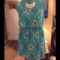 "NWT Aztec print mini dress Cute and sexy Aztec print mini dress . Fully lined, sleeveless dress in colors of Teal , orange , blue and white. Bust measures at 18"" lying flat , length from shoulder to bottom is 34"", waist is 32"" around. Criss cross design in back. Speechless Dresses Mini"