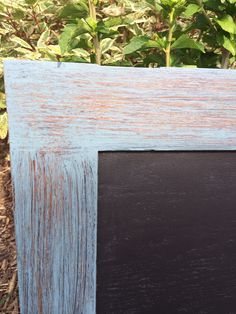 Old cabinet door turned into a distressed chalkboard