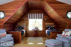 Featuring built-in trundle beds, the boys' bunkroom is an ode to the interior of a ship.