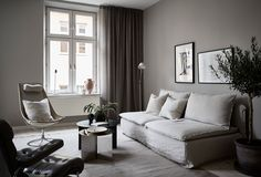 moody scandinavian interior | layered minimalism | styling Grey Deco for Stadshem | retro midcentury furniture | marble coffee table | linen sofa | IKEA Söderhamn sofa with a Bemz Loose Fit Urban cover in Unbleached Rosendal linen