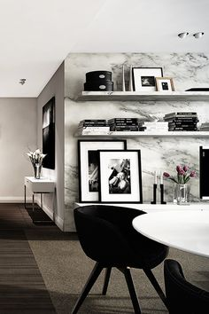 You could seriously live large with some marble-print wallpaper. -EL VIA Luxury Apartment | CKND