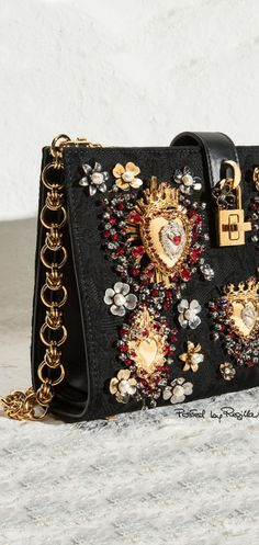 Dolce & Gabbana.embroidered and appliqué handbag with jeweled heart motif and chain.