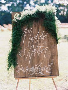 Rustic wood wedding sign: http://www.stylemepretty.com/2015/11/16/sweet-summer-garden-wedding/ | Photography: Nina and Wes - http://ninaandwes.com/