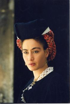 Europe | Portait of a woman wearing a traditional headdress, Scanno, province of L'Aquila, Abruzzo region, Central Italy