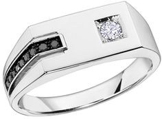 Ann-Louise Jewellers Ltd-Victoria Bay Centre/Vancouver Island Weddings/Engagement Rings/Diamond Rings/Anniversary Rings/online store/Gent Rings    Price:   $399.00  Description:   10K white gold ring with a row of 9 sapphires and center diamond 0.05ct.