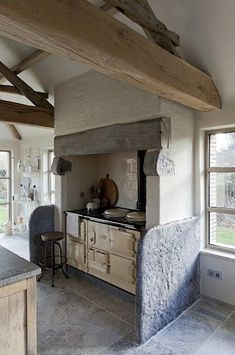 rustic farmhouse kitchen via BD...the bleu stone is original from the old cowstables [recup.] and fiths perfect here. Still found in the Flandres.