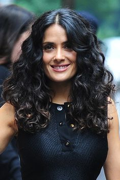 Top 15 Curly Hairstyles - Salma Hayek Long layers help give curly hair a flattering shape.