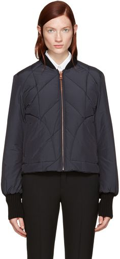 Long sleeve quilted bomber jacket in 'dark night' navy. Rib knit stand collar, cuffs, and hem. Zip closure at front. Welt pockets at waist. Fully lined. Rose gold-tone hardware. Tonal stitching. Fill: duck feather.