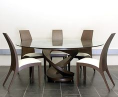 You will really love the elegant, pristine look of a dinette sets for small spaces. No matter whether you're looking for a snug spot to lounge and want to put useful furniture to the family home, a dinette sets would do it in style. Unique Dining Tables, Dining Table Design, Glass Dining Table, Dining Table Chairs, Round Dining Table, Dining Room Furniture, Ikea Dining, Low Tables, Modern Table