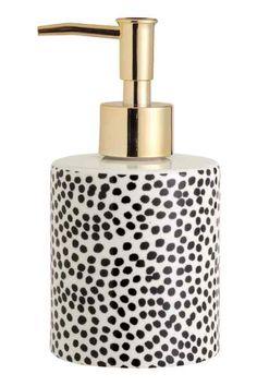 Pompe à savon en porcelaine
