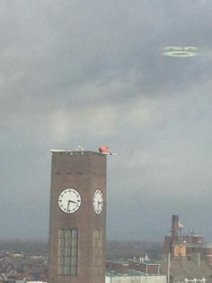 Crewe Resident Unintentionally Captures Evidence of a Cloaked Flying Saucer?A person in Crewe, Cheshire, England captured this image after they noticed a man atop a clock tower working in very unsafe...