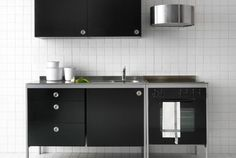 udden system from ikea with cabinets trays drawers and appliances that can slot in to the structure