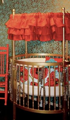 more and more I see the round cribs I want one! Love the burlap ruffled valence!
