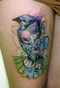 I like the idea of a regular outline tattoo with watercolor surrounding, in, and through it.
